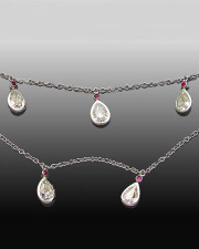 Necklace 3-8: Platinum necklace with pear shaped diamonds and small rubies set in full bezels