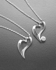 Necklace 1-10: Two floating heart pendants in white gold. One plain and one with a full bezel set diamond