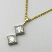 Necklace 1-11: Round cut diamonds prong set in two square white gold frames with yellow gold details