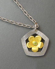 Necklace 1-5: Yellow gold flower with a yellow diamond surrounded by a white gold hammered frame