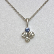 Necklace 1-7: Random sized diamonds and a blue sapphire full bezel set in white gold