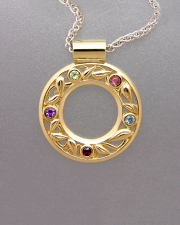 Necklace 2-3: Various colored stones full bezel set around a leaf pattern pendant in yellow gold