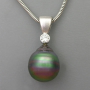Necklace 3-3: Baroque black pearl and diamond pendant in 14karat white gold