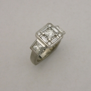 14k White gold & Princess cut Diamond ring with Baguette Halo