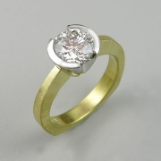Engagement Ring 1-12: Round cut diamond partial bezel set in platinum and 18k yellow gold