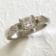 Engagement Ring 1-9: Princess cut diamond channel set with partial bezel set round side diamonds in white gold