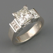 Engagement Ring 2-10: Princess cut diamond square prong set with Princess cut channel set diamonds on the sides
