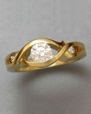 Engagement Ring 2-2: Round cut diamond partial bezel set in yellow gold with small diamonds on the side
