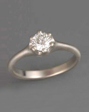 Engagement Ring 2-4: Round cut diamond prong set in white gold
