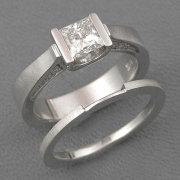 Engagement Ring 3-9: Princess cut diamond channel set in white gold with diamonds on the side shown with matching band