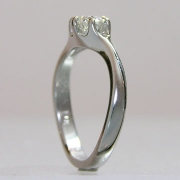 Engagement Ring 4-6: Round cut diamond prong set in white gold this a twist