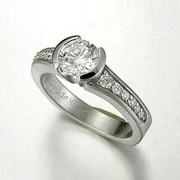 Engagement Ring 5-10: Round cut diamond partial bezel set in white gold with bead set diamonds on the sides