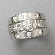 Engagement Ring 5-5: Round cut diamonds bezel and flush set in white gold
