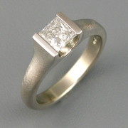 Engagement Ring 6-2: Princess cut diamond channel set in white gold