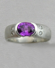 Engagement Ring 7-3: Oval cut purple sapphire partial bezel set in white gold with diamonds on the sides