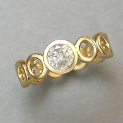 Engagement Ring 8-2: 14kt. yellow gold engagement ring with bezel set center diamond and circle motif band