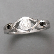 Engagement Ring 8-4: 14kt. white gold partial bezel diamond engagement ring with black diamonds on each side