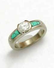 Engagement Ring 8-7: 14kt. white gold engagement ring with a round diamond partial bezel set in center and inlaid turquoise on each side