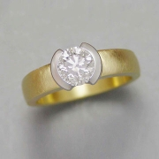 Engagement Ring 8-8: 18kt. yellow gold diamond engagement ring with center round diamond partially bezel set in a Platinum bezel