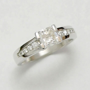 Engagement Ring 9-1: 14kt. white gold diamond engagement ring with center diamond set in split channel and bead set side diamonds