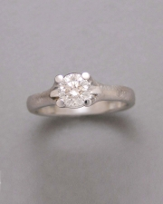 Engagement Ring 9-12: 14kt. white gold diamond engagement ring with round center diamond set in four prongs