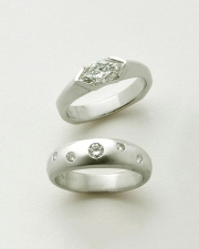 Engagement Ring 9-6: 14kt. white gold marquise diamond ring and 14kt. white gold band with flush set small diamonds