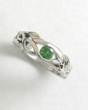 Engagement Ring 9-9: 14kt. white gold ring with organic vine details and a round tourmaline set in center