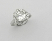 Cushion cut diamond engagement ring with vintage halo