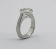 Full bezel minimalist engagement ring with exposed culet